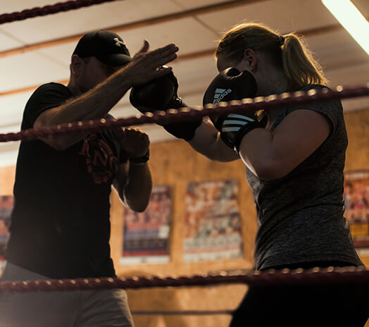 Ring3city boxing coach giving individual coaching to fighter in boxing ring